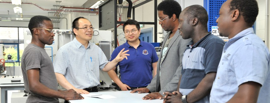 Professor Meihong Wang and PhD students in the Chemical Engineering Laboratory at the University of Hull